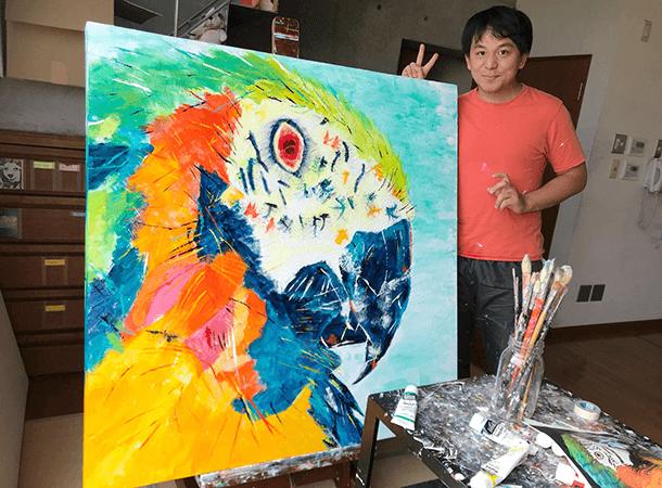 「ルリコンゴウインコ」を描いています。